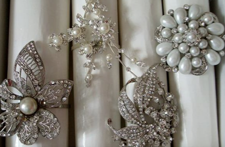 Collect gorgeous brooches to use as unique and fabulous vintage napkin holders!