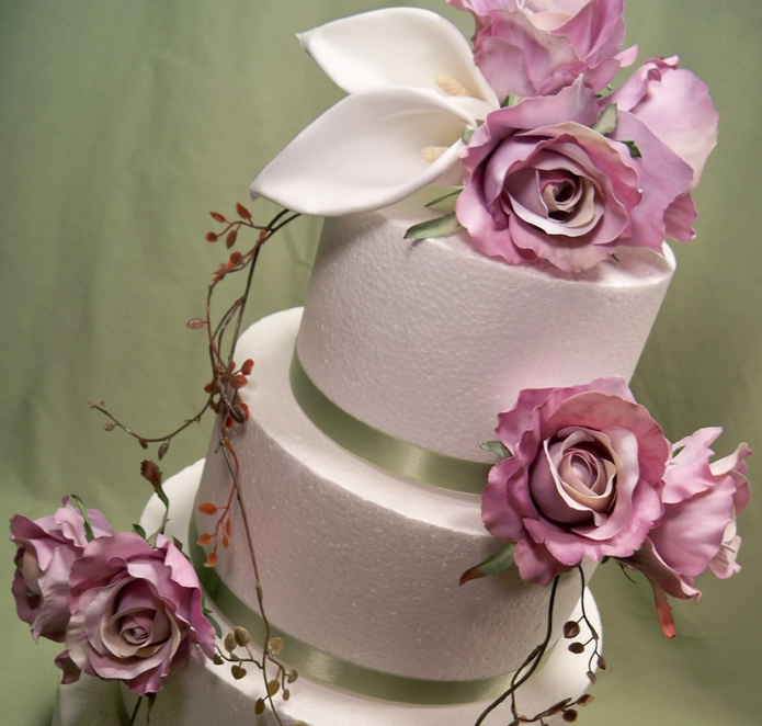 Fake flower wedding cake topper - it is important to get good quality fake flowers, so they don't look too 'fake'!