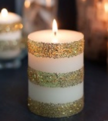 Tape, glitter and glue can create a stunning effect on a plain candle!